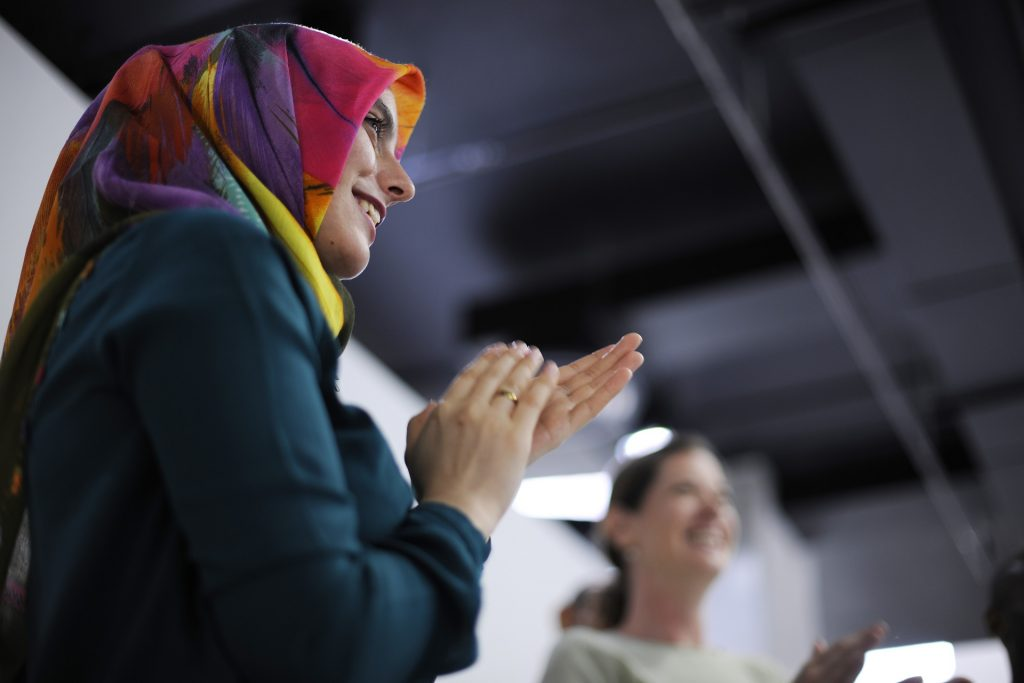 Woman clapping at work